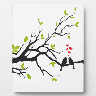 Birds in love with red hearts on spring tree plaques