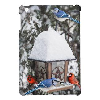 Birds on bird feeder in winter iPad mini cover