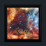 """Birth of Stars Cosmic Creation Blue Stars Name Jewelry Box<br><div class=""""desc"""">This phenomenal image from the Hubble telescope takes us deep into the heart of the Tarantula Nebula, a very active star creation region a mere 160, 000 light years from planet Earth. The star cluster is known as R136, and its activity creates much of the brilliance of this luminous nebula....</div>"""