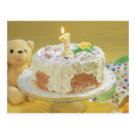 Birthday cake with one candle and teddy bear postcard