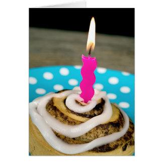 birthday candle in a cinnamon roll card