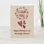 """Birthday Card for Your Husband, Nordic Design<br><div class=""""desc"""">Special birthday card for your husband with a Nordic design on a digital burlap background.  The design has a cranberry wreath around the words """"I Love You"""",  and hearts under the wreath in cranberry.  Thanks to Design Cuts for some of the elements in the design.</div>"""