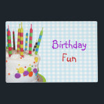 """Birthday Fun Placemat<br><div class=""""desc"""">12"""" x 18"""" paper placemat with an image,  on both sides,  of a colorful birthday cake with fun,  colorful candles on blue gingham. Optional sentiment. See matching cloth placemat,  cloth napkin,  paper cocktail napkin and coasters. See the entire Kids' Birthday Placemat collection in the FOOD/BEV 