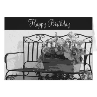 Birthday, iron bench with basket of flowers. greeting card