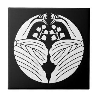 Bisected crane-shaped paulownias tile