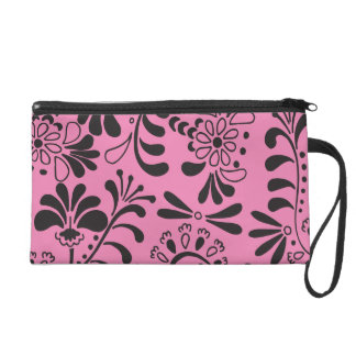 Black abstract flowers on pink wristlet purse