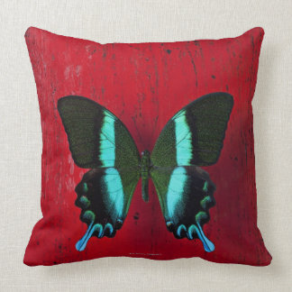 Black and blue butterfly on red wall throw pillow