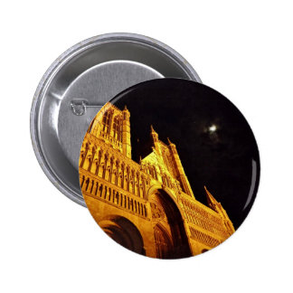 Black and gold pinback button