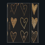 "Black and Gold Hearts Custom iPad Case<br><div class=""desc"">Stylish iPad 2/3/4 case done black,  with gold tone glitter looking whimsical hearts.  Personalize the golden brown text,  on the front,  for yourself or as a great gift idea.</div>"