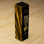 "Black and Gold Wine Box<br><div class=""desc"">Rich,  luxurious and elegant wine box with champagne flute design on front and back with a textured gold effect pattern on the sides. Perfect for gifts of sparkling wine. Customize with your own Christmas greetings and text.</div>"