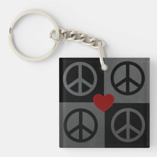 Black and grey blocks and reverse peace symbols keychains