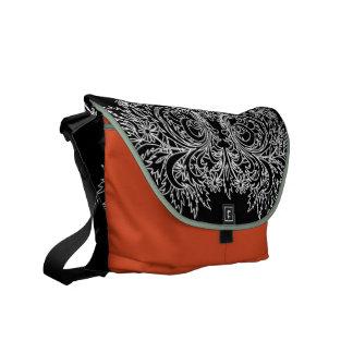 Black and orange scroll pattern messenger bag