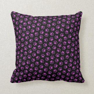 Black and purple paw print animal track pattern throw pillow
