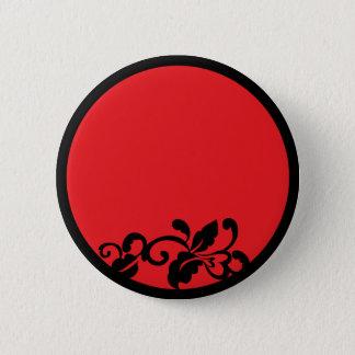 black and red flourish pinback button