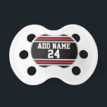 """Black and Red Sports Jersey Custom Name Number Pacifier<br><div class=""""desc"""">If you are a Fantasy Football team owner,  make your own products and show off to your friends! Or - Do you play High School Football and want a memento? This sports design is perfect for any athlete playing soccer or baseball.</div>"""