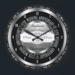 """Black and Silver Elegant 25th Wedding Anniversary Large Clock<br><div class=""""desc"""">A lifetime of commitment deserves the quality of a custom gift.  Let the all important couple know how much they inspire you with our original black and silver tone twenty-fifth anniversary design. Personalize with names as well as wedding date and anniversary date.  Original design created by Holiday Hearts Designs.</div>"""