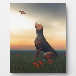 Black and tan hound dog and bird plaque