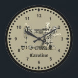"""Black and Tan Vintage Sewing Machine Clock<br><div class=""""desc"""">This clock face is printed with a vintage style sewing machine image in a black and cream dingbat pattern on a neutral background. Personalize it with name or other text for your favorite sewing or quilting artist.Nice accent for any sewing or crafting room. Your choice of sizes.</div>"""