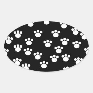 Black and White Animal Paw Print Pattern. Oval Sticker