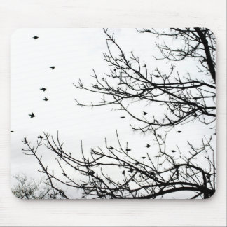 Black and White Birds Flying Off Trees Mousepad