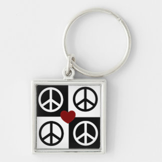 Black and white blocks and reverse peace symbol keychain