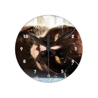 black and white cat face animal photo yellow eyes round clock