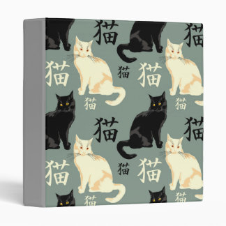 Black and white cats with hieroglyph binder
