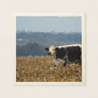 Black and White Cow grazes in freshly plowed field Paper Napkin