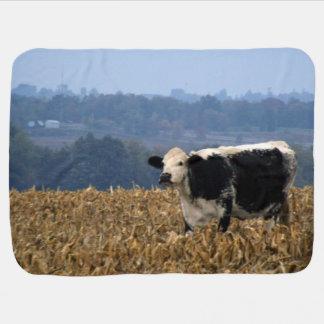 Black and White Cow grazes in freshly plowed field Stroller Blanket