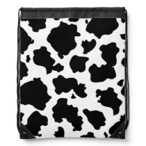 Black and white cow print backpack
