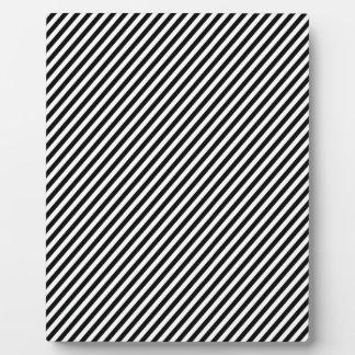 Black and white diagonal stripes display plaques
