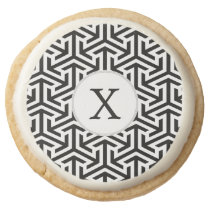 black and white geometrical pattern round shortbread cookie