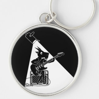 Black and white goat playing an electric guitar keychain