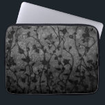 "Black and White Gothic Antique Floral Computer Sleeve<br><div class=""desc"">Unique contrasting textures and shades with floral vines creating a decorative silhouette pattern against a dark background.</div>"