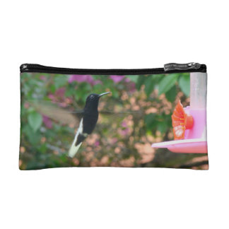 Black and White hummingbird flying at a feeder Cosmetics Bags