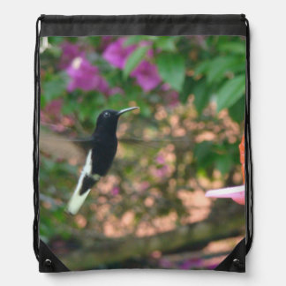 Black and White hummingbird flying at a feeder Cinch Bags