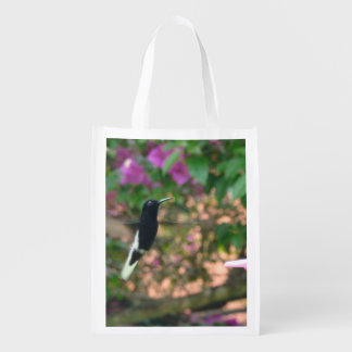 Black and White hummingbird flying at a feeder Reusable Grocery Bags