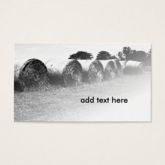black and white image of large rolled hay bales business card