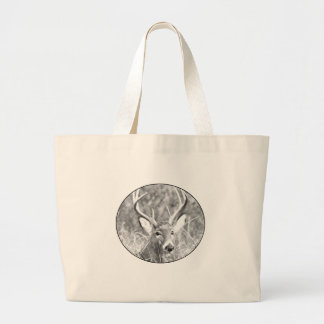 Black and white image of white tailed buck bags