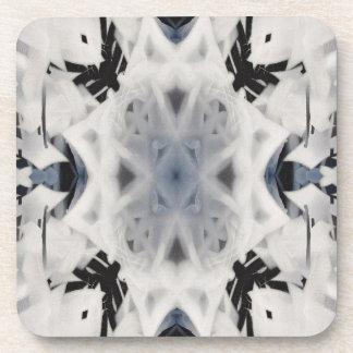 Black and white kaleidoscope graffiti coaster