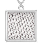 Black and white lattice fence design pendant