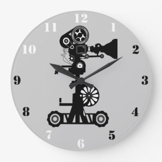 BLACK AND WHITE MOVIE CAMERA WITH NUMERALS LARGE CLOCK
