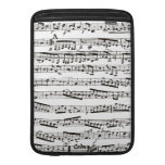 Black and white musical notes MacBook sleeve