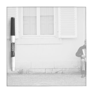 Black and white of man and accordian dry erase boards