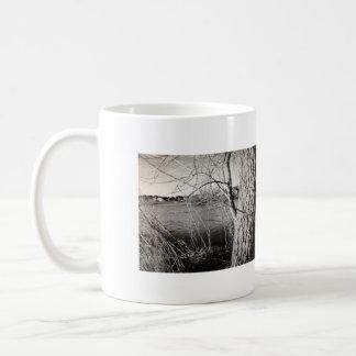 Black and white of tree and lake scene. coffee mug