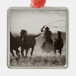 Black and White photo of a Cowboy Lassoing Horses Metal Ornament