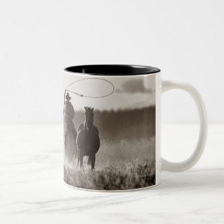 Black and White photo of a Cowboy Lassoing Horses Two-Tone Coffee Mug