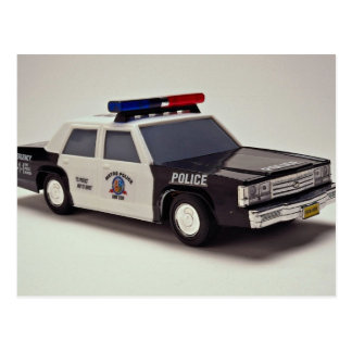 Black and white police car postcard