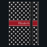 """Black and White Polka Dots Cranberry Name Monogram iPad Mini Case<br><div class=""""desc"""">Black and White Polka Dot Pattern, Cranberry Red Ribbon Name Monogram Label Customize this with your name, monogram or other text. You can also change the font, adjust the font size and font color, move the text, add or adjust text fields, etc. Need this pattern in other colors or designs?...</div>"""