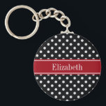 """Black and White Polka Dots Cranberry Name Monogram Keychain<br><div class=""""desc"""">Black and White Polka Dot Pattern, Cranberry Red Ribbon Name Monogram Label Customize this with your name, monogram or other text. You can also change the font, adjust the font size and font color, move the text, add or adjust text fields, etc. Need this pattern in other colors or designs?...</div>"""